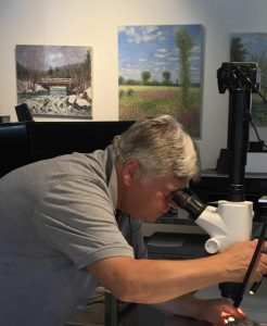 Paul Biro intently working in his lab.
