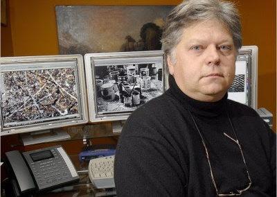 Paul Biro in front of his computer monitors